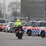 Politieauto's en politiemotor in Barendrecht