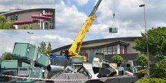 Grootschalige werkzaamheden in Inge de Bruijn Zwembad: Apparatuur via een gat in het dak naar buiten