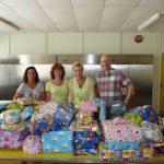Cadeautjes voor kinderen voedselbank van opbrengst beurs Carnisse Haven